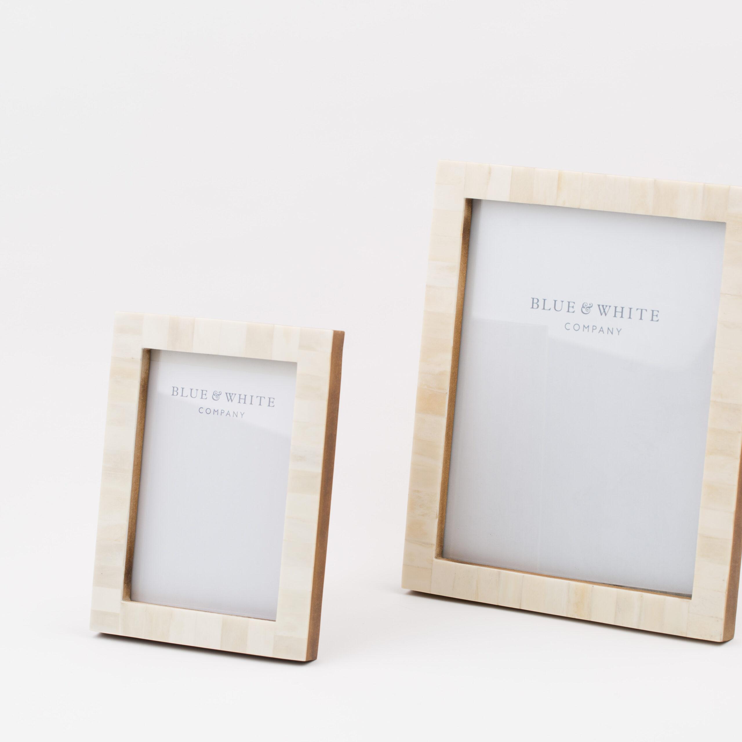 ivory coloured photo frames blue white company